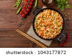 fried rice with chicken.... | Shutterstock . vector #1043177872
