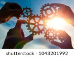 silhouettes four hands collect... | Shutterstock . vector #1043201992