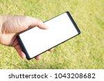 female hand holding the... | Shutterstock . vector #1043208682