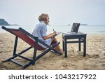 freelancer designer with laptop ... | Shutterstock . vector #1043217922