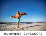 summer lovers on beach and blue ... | Shutterstock . vector #1043223742