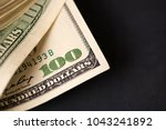 close up of stack of dollars on ... | Shutterstock . vector #1043241892