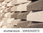 Small photo of acoustic foam wall pattern random color grey tone background.