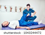 senior man on a physiotherapy...   Shutterstock . vector #1043244472