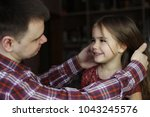 adult father looking with love... | Shutterstock . vector #1043245576