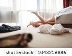 legs sticking out from behind... | Shutterstock . vector #1043256886