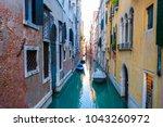 typical venice narrow water... | Shutterstock . vector #1043260972