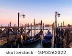 venice with famous gondolas  in ... | Shutterstock . vector #1043262322