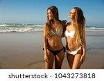 beautiful girls in a summer day ... | Shutterstock . vector #1043273818