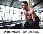 strong muscular man is working... | Shutterstock . vector #1043286802