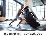 strong muscular man is working... | Shutterstock . vector #1043287018