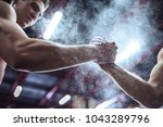 cropped image of strong... | Shutterstock . vector #1043289796