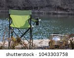camping chairs lake side | Shutterstock . vector #1043303758
