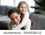 happy single mother laughing... | Shutterstock . vector #1043328112
