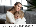 loving single mother hugging... | Shutterstock . vector #1043328118