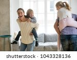 happy mother laughing... | Shutterstock . vector #1043328136