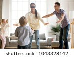 family playing hide and seek... | Shutterstock . vector #1043328142