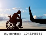 silhouette of sad disabled man... | Shutterstock . vector #1043345956
