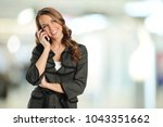 young businesswoman on the cell ... | Shutterstock . vector #1043351662