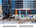 facing the building with a... | Shutterstock . vector #1043351926