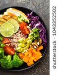 buddha bowl meal with chicken... | Shutterstock . vector #1043352502