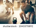 fit young man in sportswear... | Shutterstock . vector #1043370892