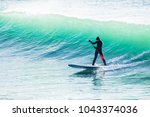 surfer on sup board on ocean... | Shutterstock . vector #1043374036