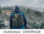 man with backpack hiking in... | Shutterstock . vector #1043390128