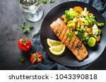 Stock photo grilled salmon fillet with vegetables mix 1043390818