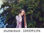 fashion portrait of smiling...   Shutterstock . vector #1043391196