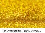 golden beautiful blurred bokeh... | Shutterstock . vector #1043399032