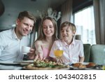 eating happy family with child... | Shutterstock . vector #1043402815