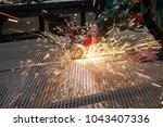 factory worker using electric... | Shutterstock . vector #1043407336