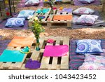 ornate picnic table setting in... | Shutterstock . vector #1043423452