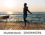 young sportsman in sportswear ... | Shutterstock . vector #1043444296