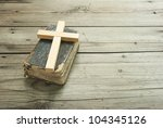 old holy bible and purity wood cross on rustic wooden table - stock photo