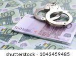 Police Handcuffs Lies On A Set...