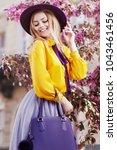 outdoor portrait of young... | Shutterstock . vector #1043461456