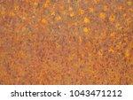 rusty yellow metal surface.... | Shutterstock . vector #1043471212