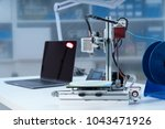 3d printer and computer on the... | Shutterstock . vector #1043471926