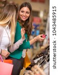 smiling women buying and... | Shutterstock . vector #1043485915