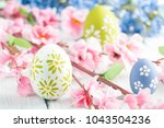 colorful easter eggs and flowers | Shutterstock . vector #1043504236