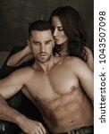beautiful loving couple posing   Shutterstock . vector #1043507098