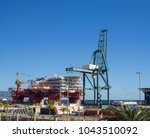 Small photo of Spain, Canary islands, Tenerife, Santa Cruz de Tenerife, December 27, 2017: Flotel, Floatel Reliance platform, floating hotel with huge crane and cargo in in Santa Cruz De Tenerife port harbor
