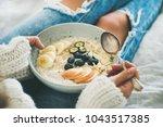 healthy winter breakfast in bed.... | Shutterstock . vector #1043517385