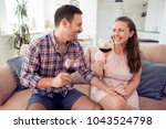 young romantic couple sitting... | Shutterstock . vector #1043524798