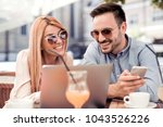 man and woman sitting in street ... | Shutterstock . vector #1043526226
