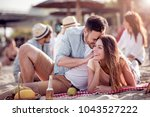 portrait of happy couple on the ... | Shutterstock . vector #1043527222