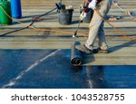 worker preparing part of... | Shutterstock . vector #1043528755