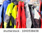 clothes on a hanger in clothes... | Shutterstock . vector #1043538658